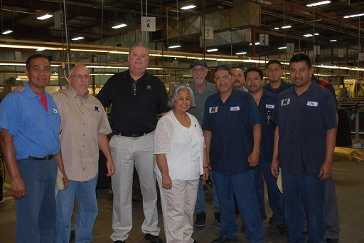 Congresswoman Gloria Negrete McLeod shown with members of the Metric Machining shop team.