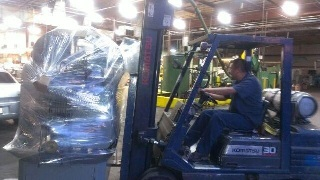 Rey moving the machine off the delivery truck.