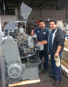 Rey and Sal unpacking the machine.